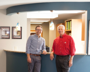 Dr. Schumacher and Dr. Bauer at the front desk