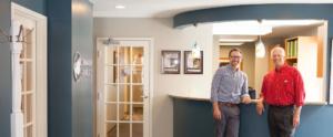 Dr. Schumacher & Dr. Bauer at the front desk