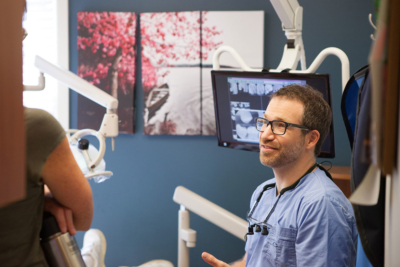 Photo of Dr. Bauer talking with a patient about Teeth Discoloration