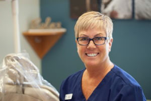 Photo of Joan of Schumacher & Bauer, DDS, smiling before her retirement starts