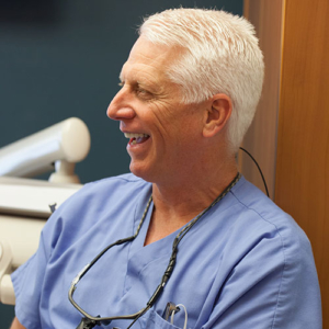 Dr. Schumacher smiling, discussing dentistry options