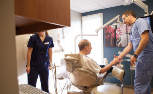 Dr. Bauer discussing with a patient Dentures, partial dentures and overdentures at Schumacher & Bauer, DDS
