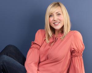 Photo of Heather VanVorhis, Schumacher & Bauer Dental Hygiene Team, on blue background