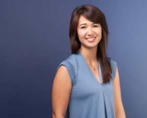 Headshot of Sara Ingle, Dental Hygienist at Schumacher and Bauer in Columbus, on blue background