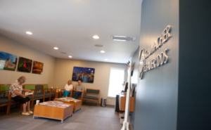 Waiting area at Schumacher & Bauer, DDS, with patients waiting for their regular preventative cleanings