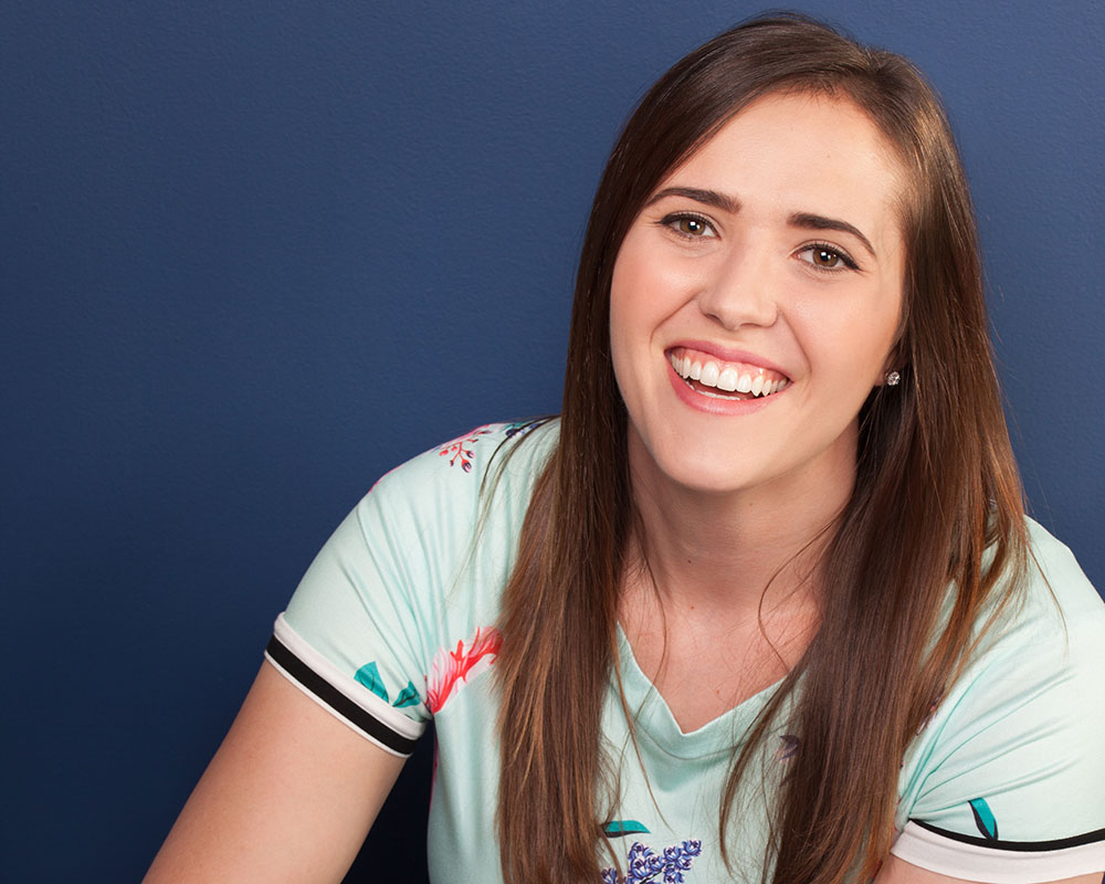 Headshot of Whitni Nye, Dental Hygienist at Schumacher and Bauer in Columbus, on blue background