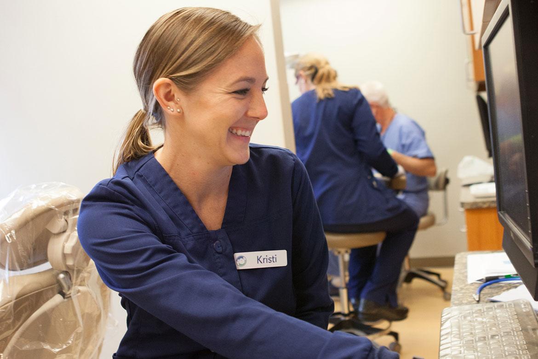 Dental implants, blog post by Kristi, photo of Kristi smiling talking about dental implants
