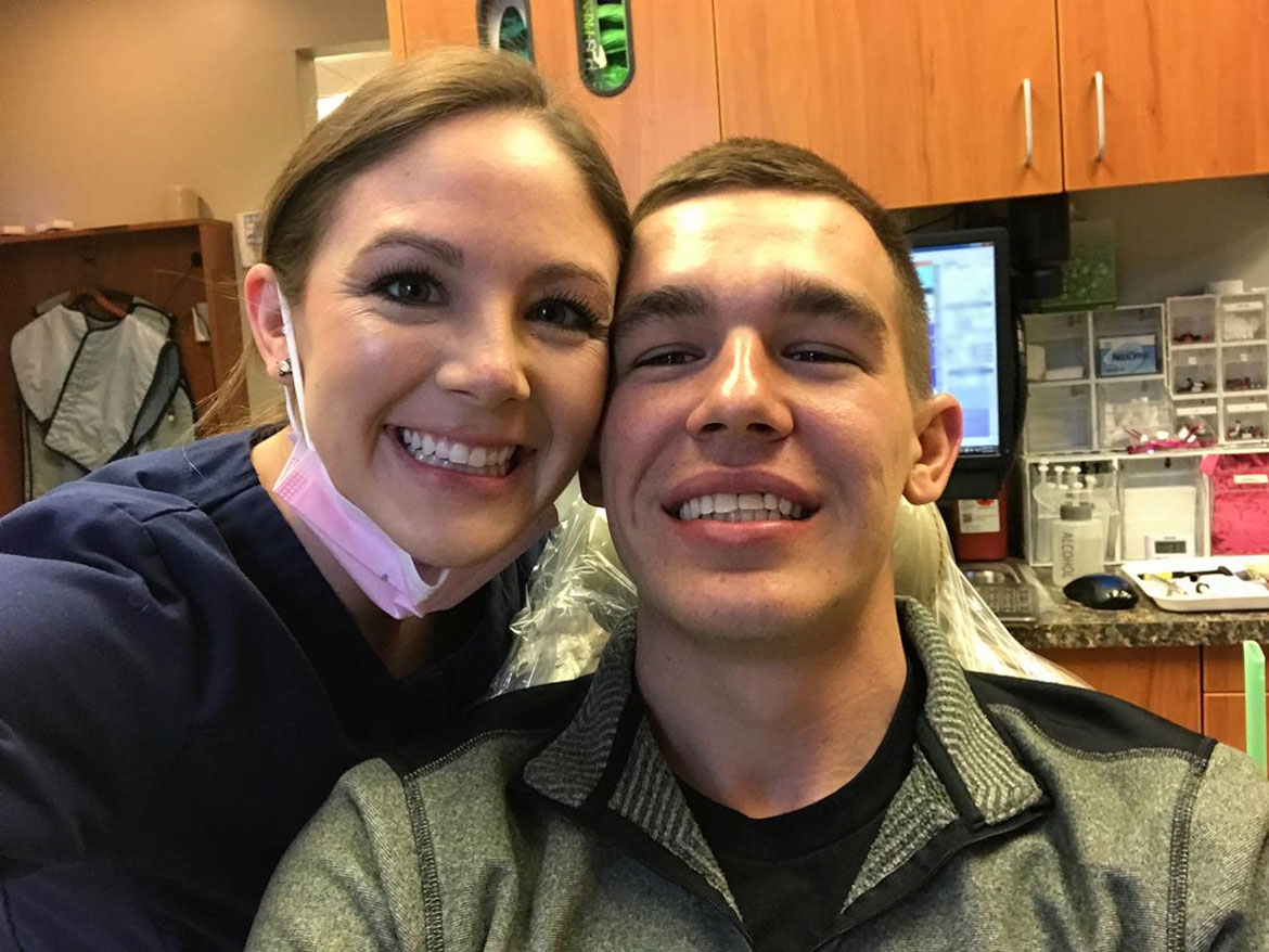 Dental implants at Schumacher & Bauer, DDS, photo of Kristi with her brother after he got dental implants