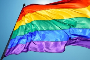 Dentist Gay Friendly, Schumacher & Bauer DDS, photo of Pride flag with the sun behind it