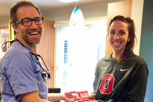 Schumacher & Bauer Ohio State Patient Giveaway, Dr. Bauer smiling with Margaret, the winner of the Ohio State tickets