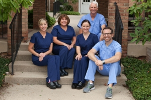 Mary with the other two dental hygienists and Dr. Schumacher and Dr. Bauer