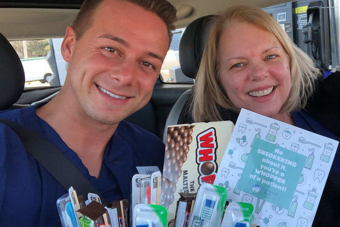 Heidi and Jake delivering the patient of the month candy bouquet
