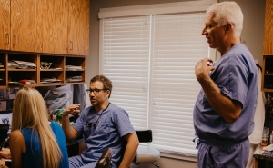 Dr. Bauer and Dr. Schumacher with Kelly in the office