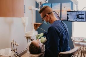 Dental hygienist cleaning teeth at Schumacher & Bauer
