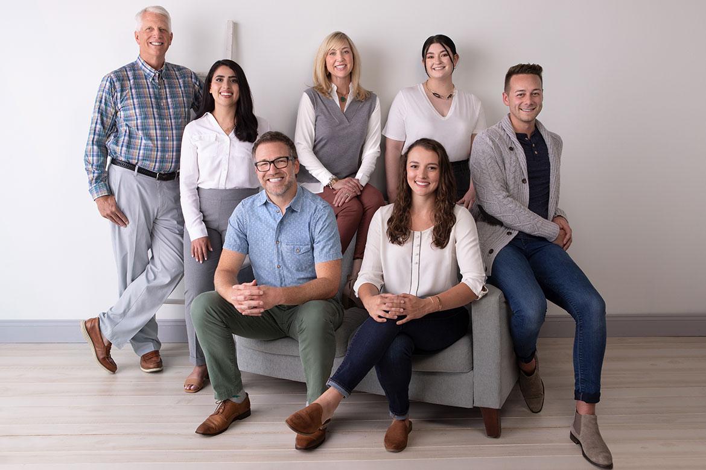 Schumacher & Bauer Hygiene Team sitting together in a bright room